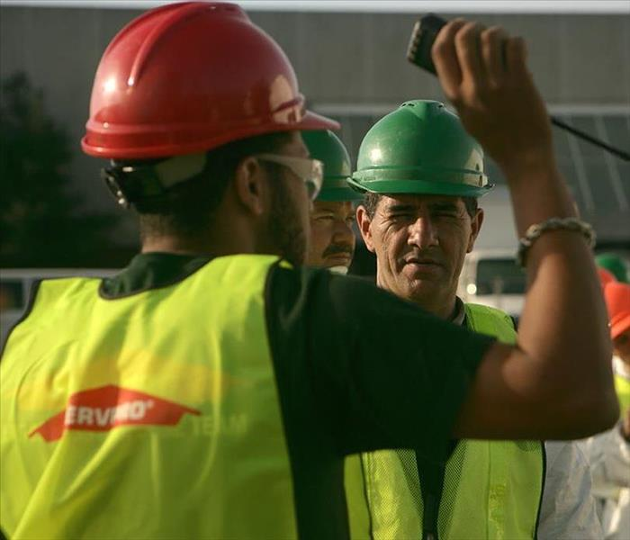 servpro employee in a vest and hard hat